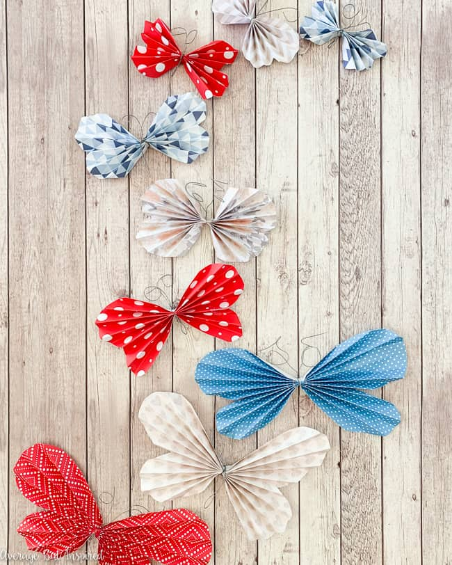 Cute! Learn how to make paper butterflies with scrapbook paper and use them for crafts, decor, gift wrapping toppers, and more!