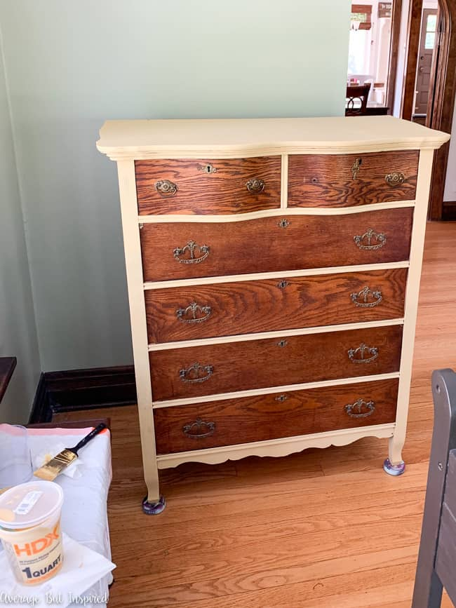 This tall dresser got a two-tone makeover with mustard yellow paint and natural wood.