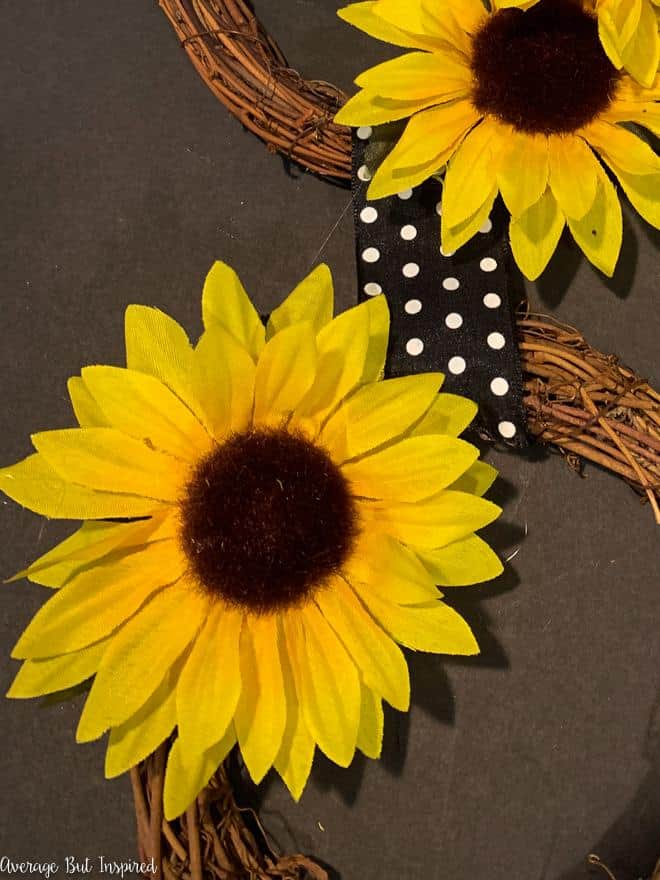 Use Dollar Tree sunflowers to make a beautiful end-of-summer wreath.