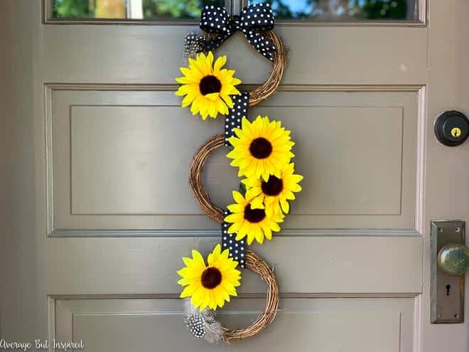 Create gorgeous end-of-summer decor with this DIY Dollar Tree Sunflower Wreath project! Make this pretty sunflower wreath for about $5.