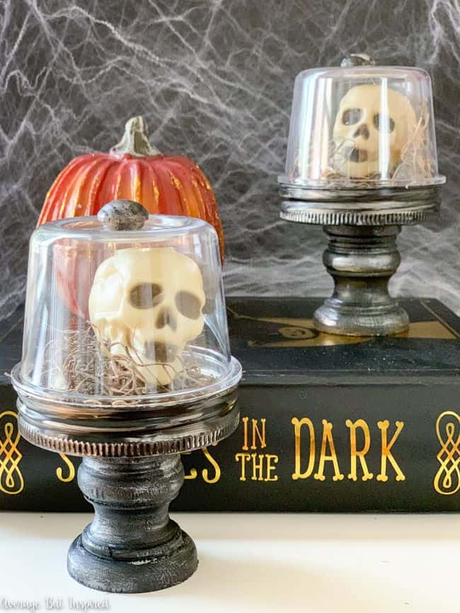 This Halloween skull decoration is creepy and cute at the same time! Make a Halloween cloche with miniature skulls in under 20 minutes!