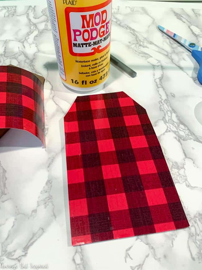 Buffalo plaid wrapping paper adds a festive touch to this Christmas craft.