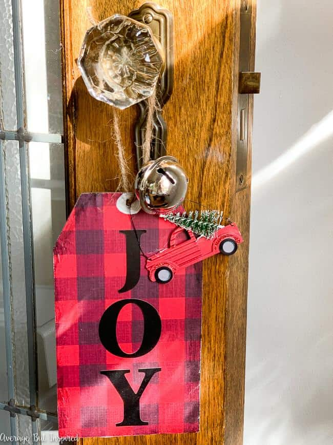 Add a dash of charm to your Christmas decor with these dollar store DIY decor tags! The buffalo check wrapping paper makes these tags on trend for Christmas this year! Using only dollar store supplies, you can make these large tags to add to wreaths, vases, to use as ornaments, to put in tiered trays, or to hang from a doorknob! The possibilities are endless, and these are such a cute Christmas craft!