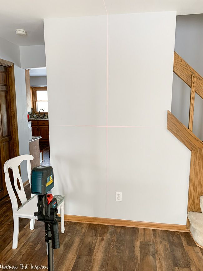 Learn how to paint a grid accent wall in this post. The laser level is very helpful when painting a DIY accent wall.