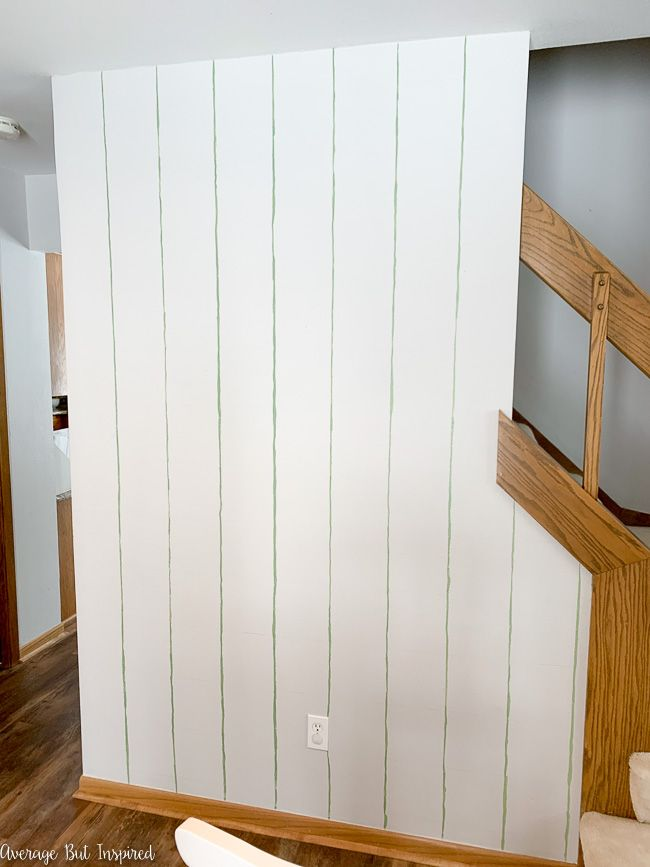 To paint a grid accent wall, go over the vertical lines with craft paint first.
