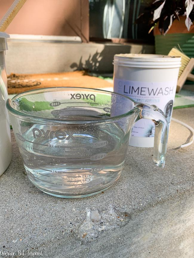 Limewash mixes with water before application.