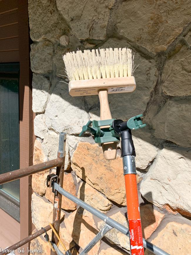 A pole extender comes in handy when limewashing rock in hard to reach places.