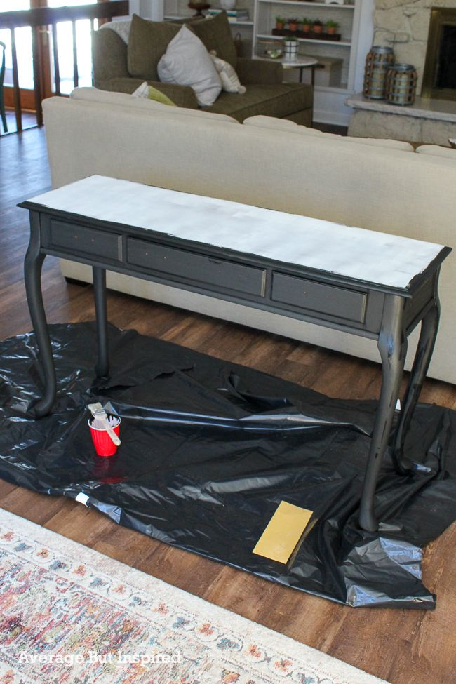 This is the process shot of the cherry table makeover. The top is primed, and the base is painted black.